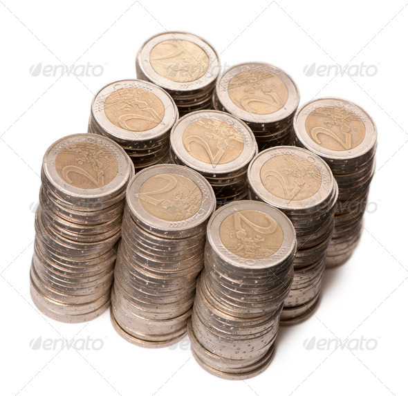 Stacks of 2 Euros Coins in front of white background, high angle view - Stock Photo - Images