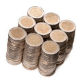 Stacks of 2 Euros Coins in front of white background, high angle view