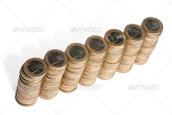 Stacks of 1 Euros Coins in front of white background, high angle view - Stock Photo - Images