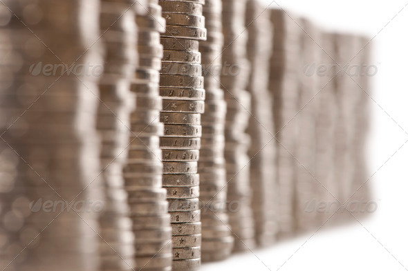 Close-up stacks of 2 Euros Coins in front of white background - Stock Photo - Images