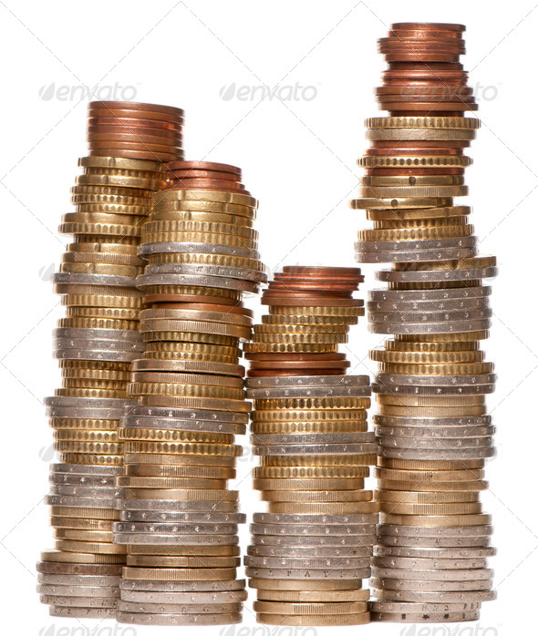 Stacks of various Euro coins in front of white background - Stock Photo - Images
