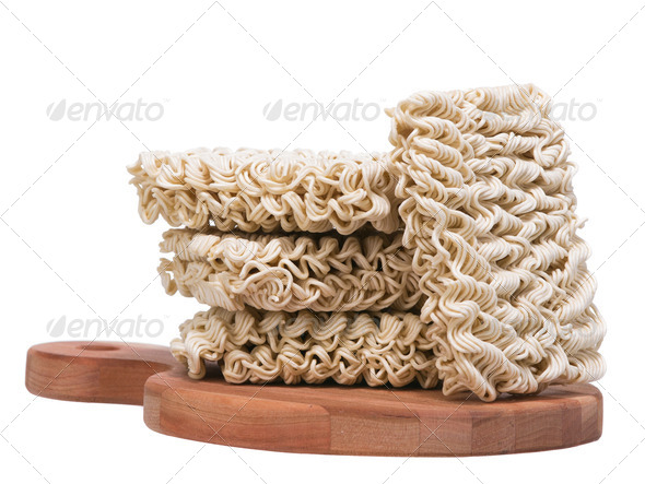 Ramen instant raw noodles on wooden plank 3/4 general view - Stock Photo - Images