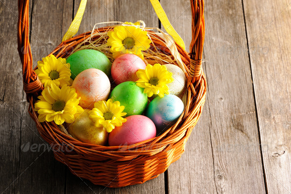 Colored easter eggs in basket - Stock Photo - Images