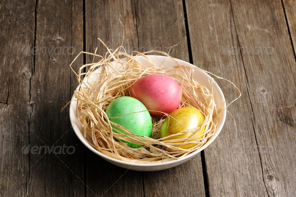 Colored easter eggs in nest - Stock Photo - Images