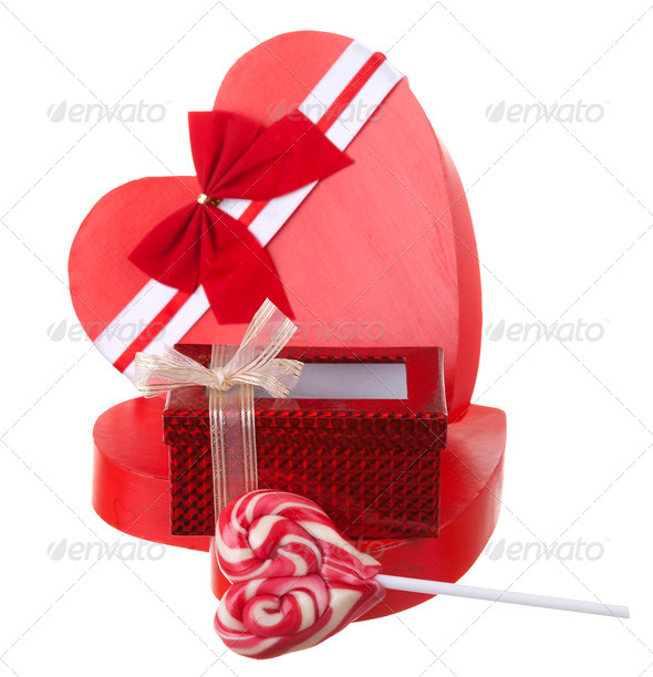 Red box in heart shape with a lollypop isolated on white backgro - Stock Photo - Images