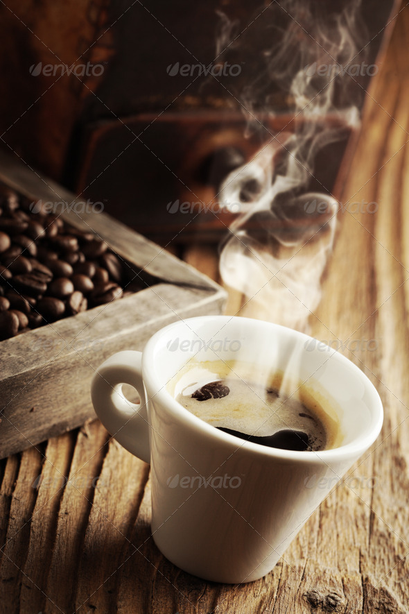 Smoking hot coffee with coffee beans - Stock Photo - Images