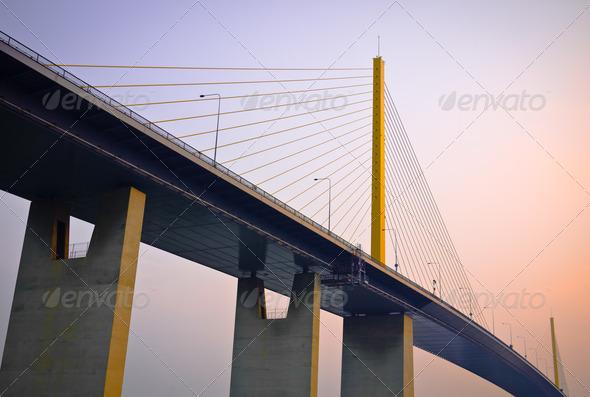Suspension bridge at the dawn - Stock Photo - Images