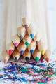 triangular pile of colored wooden pencils
