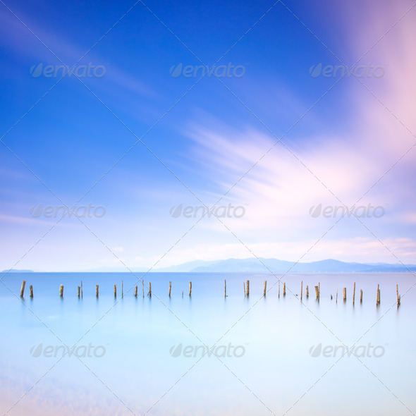 Poles and soft water on sea landscape. Long exposure. - Stock Photo - Images