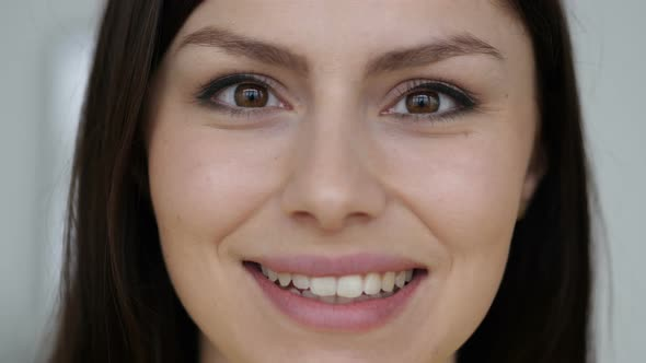 Close Up Of Smiling Face Of Young Woman Looking At Camera