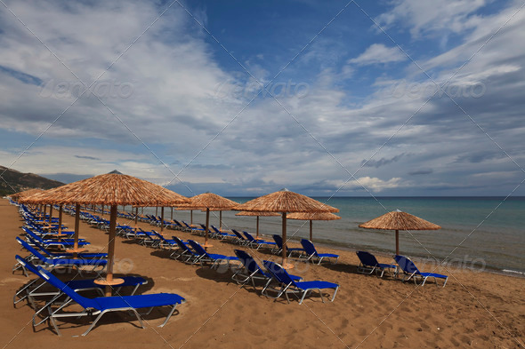 a beach filled with sun beds - Stock Photo - Images