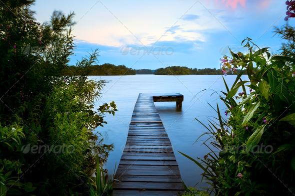 wooden pier in summer on lake - Stock Photo - Images