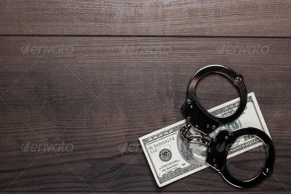 Handcuffs And One Hundred Dollars Background - Stock Photo - Images