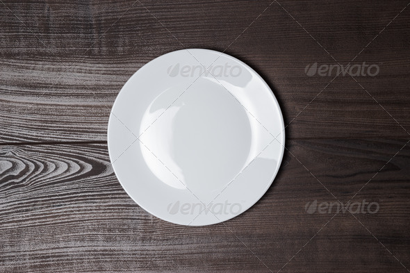 White Plate On Wooden Brown Table - Stock Photo - Images