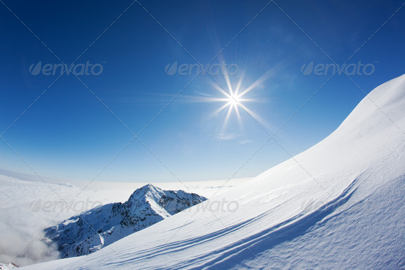Snowy mountain landscape in a winter clear day. Western Alps, Piemonte, Italy. - Stock Photo - Images