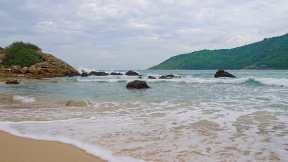 Seashore Sandy Beach Overlooking the Islands