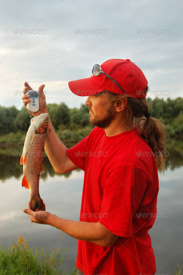 Fisherman and fish - Stock Photo - Images