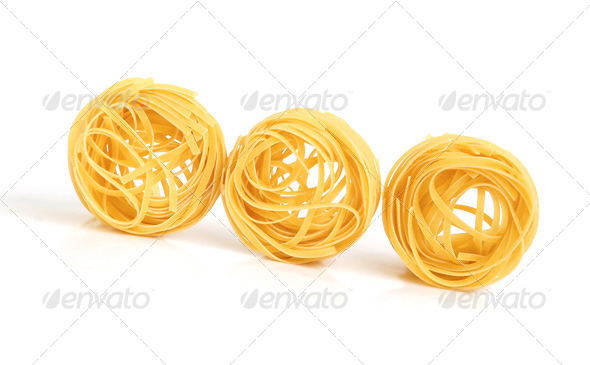 Uncooked macaroni - Stock Photo - Images