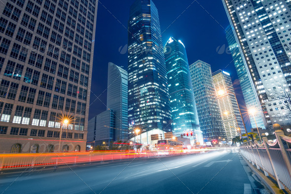 light trails on the street with modern building - Stock Photo - Images