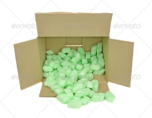 Cardboard Box with Packing Chips - Stock Photo - Images