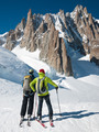 skiers in front of the breathtaking view of Mont Blanc de Tacul - PhotoDune Item for Sale