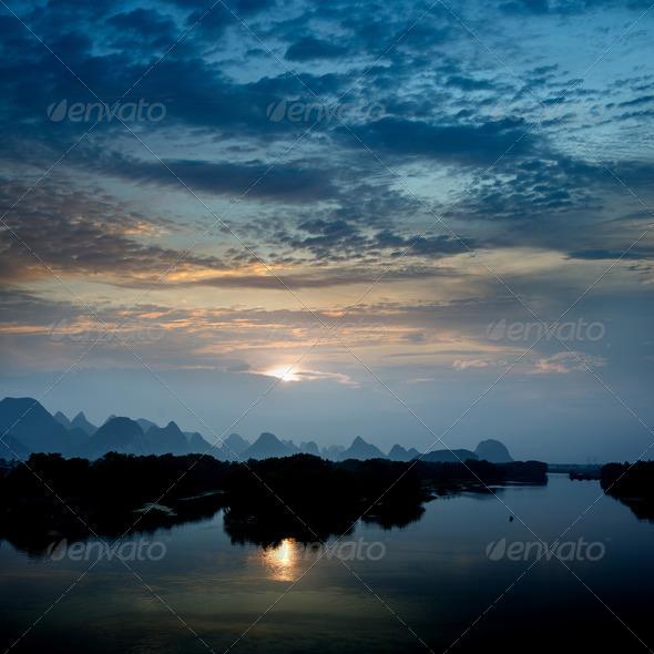 karst mountain landscape and reflection - Stock Photo - Images