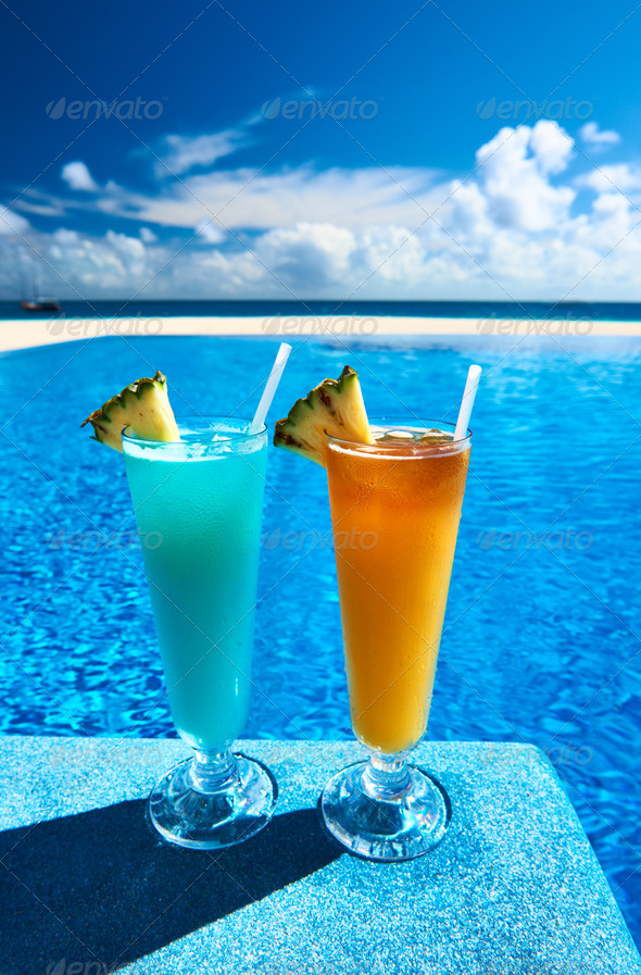 Cocktails near swimming pool - Stock Photo - Images
