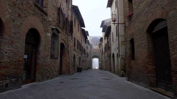 San Gimignano, Italy. Walking a Narrow Street of the Medieval Town