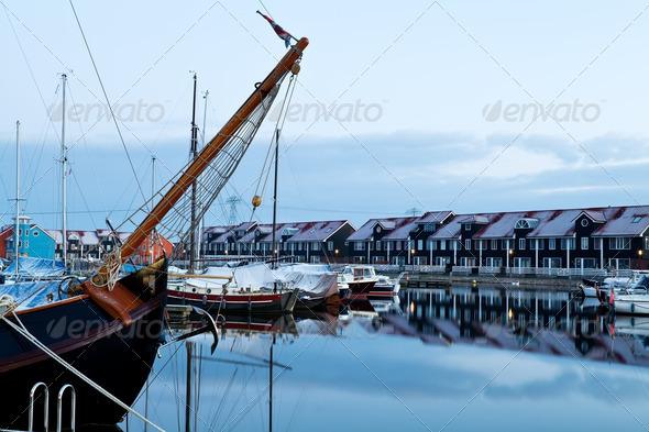ship and yacht at marina before sunrise - Stock Photo - Images