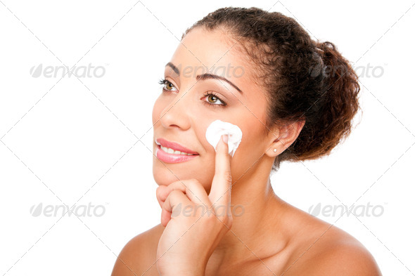 Facial cream beauty treatment - Stock Photo - Images
