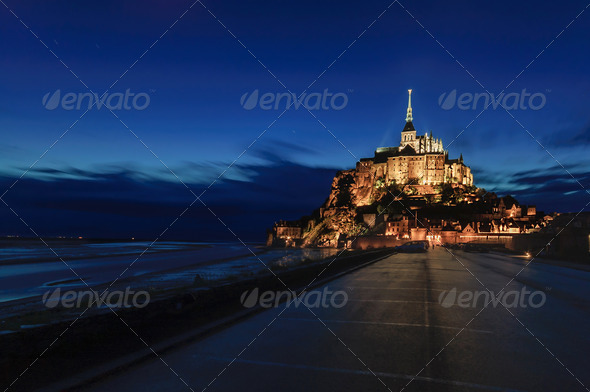 Mont Saint Michel monastery and bay landmark night view. Normandy, France - Stock Photo - Images