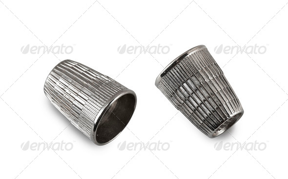 vintage and used silver thimble on white (CLIPPING PATH) - Stock Photo - Images