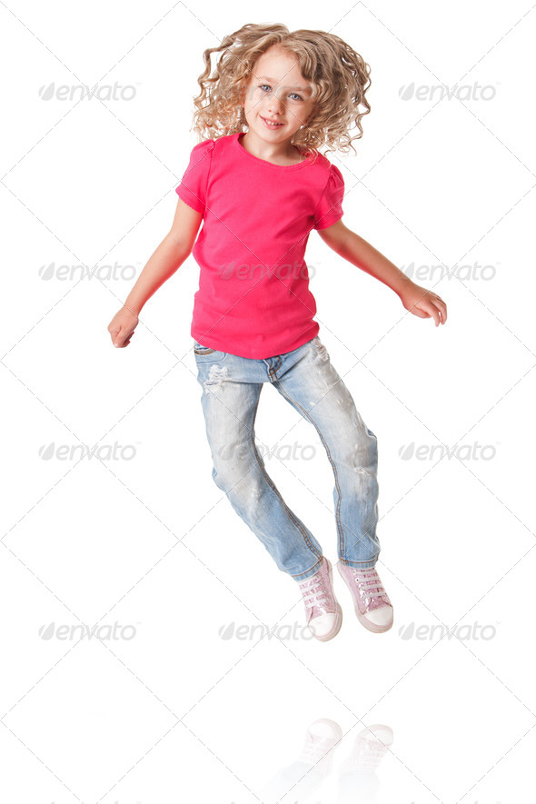 Happy jumping girl with heels together - Stock Photo - Images