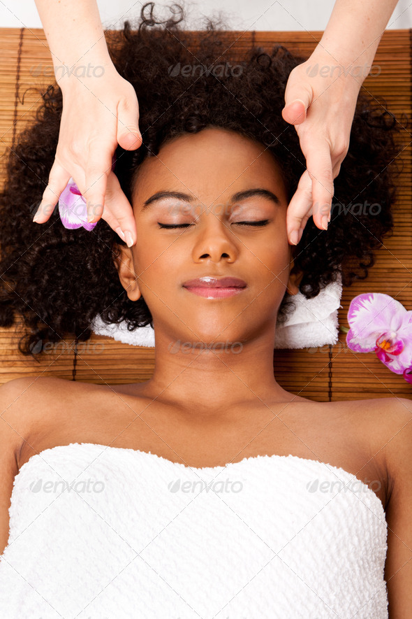 Facial temple massage in beauty spa - Stock Photo - Images