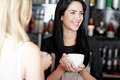 Women chatting over coffee at wine bar - PhotoDune Item for Sale