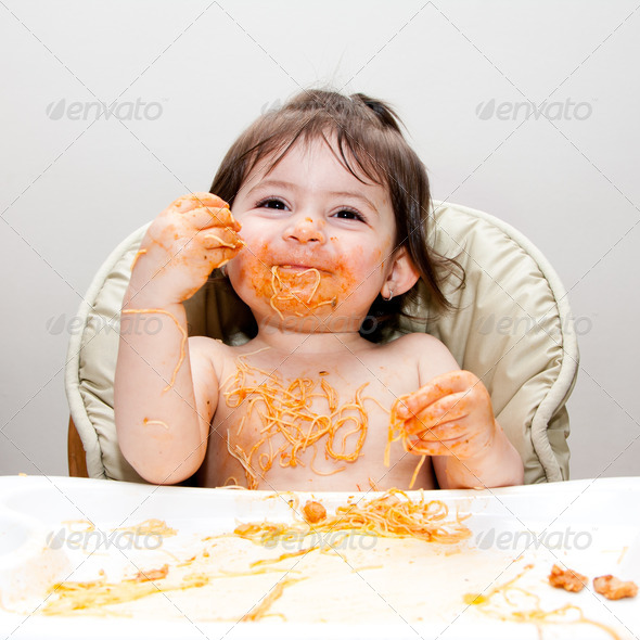 Happy fun messy eater - Stock Photo - Images
