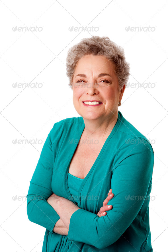 Happy smiling senior woman with arms crossed - Stock Photo - Images