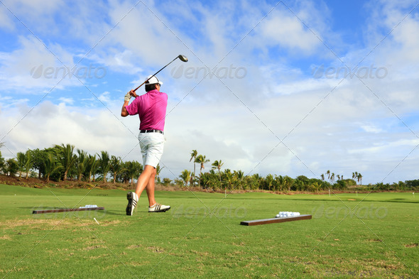 golf player teeing - Stock Photo - Images