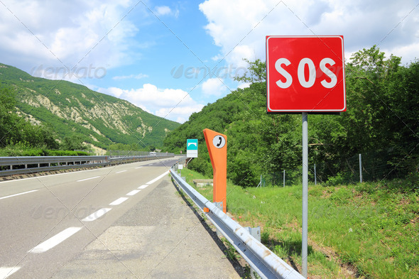 Emergency phone and sos sign on road - Stock Photo - Images