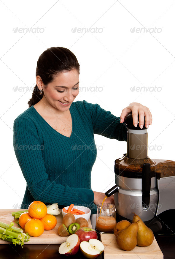 Woman making fruit juice - Stock Photo - Images