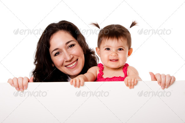 Mother and baby daughter holding white board - Stock Photo - Images