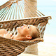 Young Cute Girl Relaxing on Hammock at the Beach - VideoHive Item for Sale