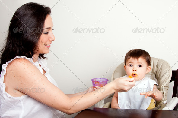 Funny baby messy eater - Stock Photo - Images
