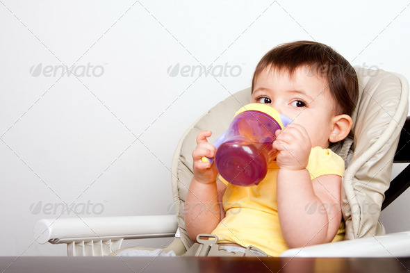 Baby infant drinking from sippy cup - Stock Photo - Images