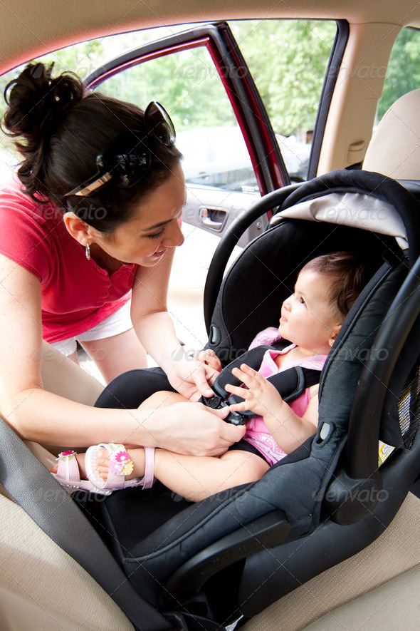 Baby in car seat for safety - Stock Photo - Images
