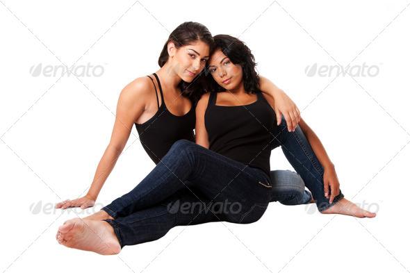 Female couple sitting together - Stock Photo - Images