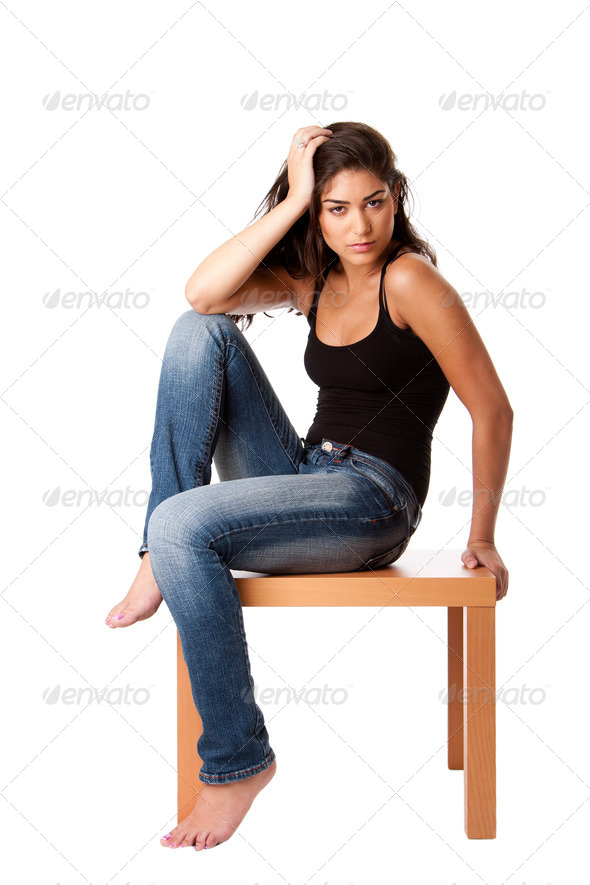 Fashion woman with jeans sitting - Stock Photo - Images