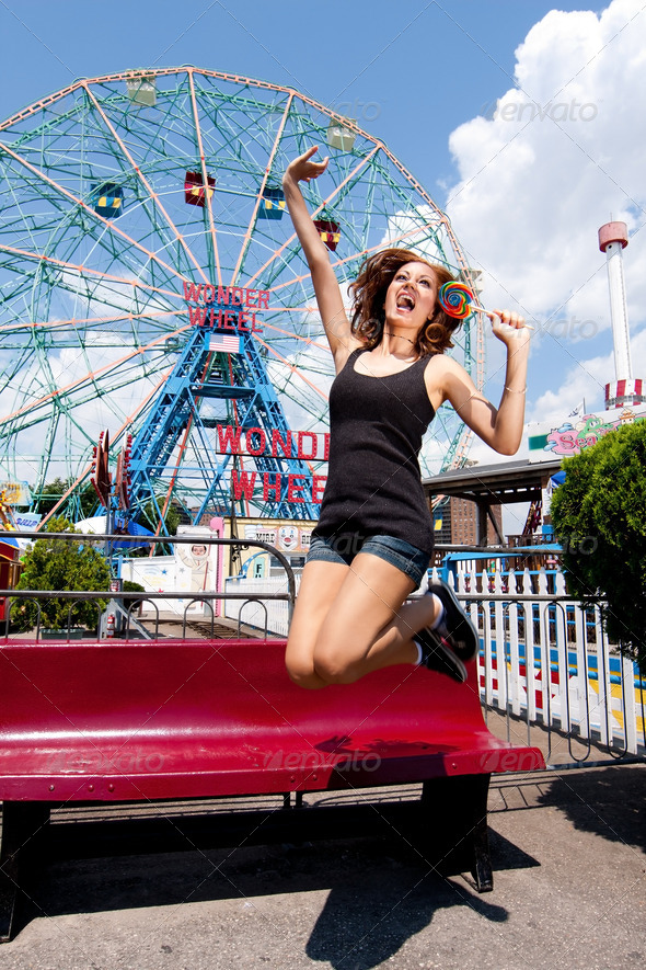 Girl having fun in amusement park - Stock Photo - Images