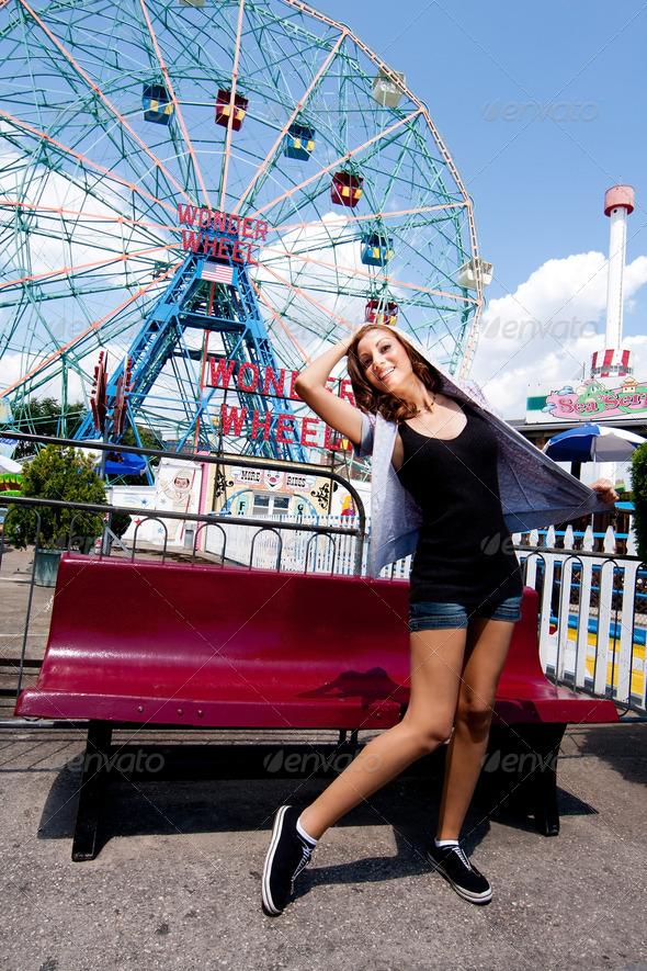Girl having fun in amusement park - Stock Photo - Images