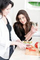 Two friends in a kitchen cooking - PhotoDune Item for Sale